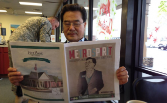 Eugene Yu reads an article about his candidacy in the Metro Spirit, an Augusta-based news publication.
