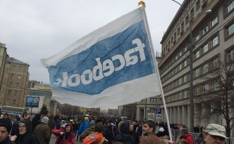 A Facebook flag being flown at a recent peace march in Moscow.